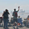 Fans wave and take pictures of a plane after performing during Saturday's Rocky Mountain Airshow 2012 at Rocky Mountain Metropolitan Airport. <br /> <br /> August 26, 2012<br /> staff photo/ David R. Jennings