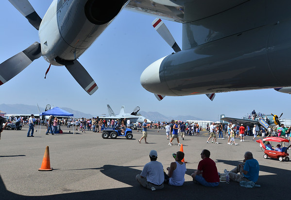 Spectators sit in the shade of the NCAR Snowflake C-130 during Saturday's Rocky Mountain Airshow 2012 at Rocky Mountain Metropolitan Airport. <br /> <br /> August 26, 2012<br /> staff photo/ David R. Jennings