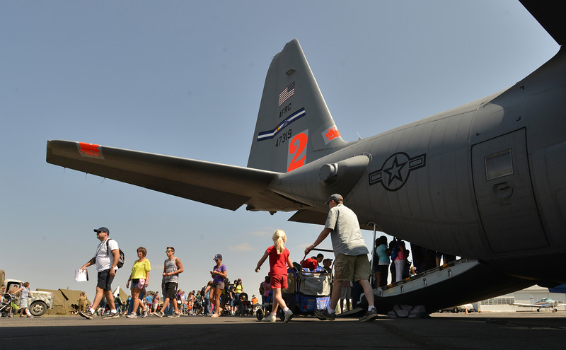 Spectators walk by a U.S.air Force C-130 during Saturday's Rocky Mountain Airshow 2012 at Rocky Mountain Metropolitan Airport. <br /> <br /> August 26, 2012<br /> staff photo/ David R. Jennings