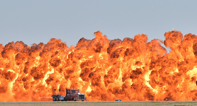 The Rocketbilly jet truck, driven by Billy Berg, races down the runway as a wall of fire explodes behind him during Saturday's Rocky Mountain Airshow 2012 at Rocky Mountain Metropolitan Airport. <br /> August 26, 2012<br /> staff photo/ David R. Jennings