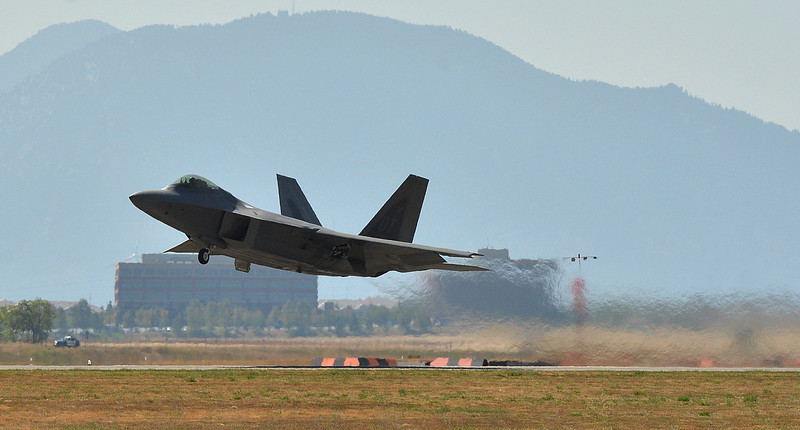 U.S. Air Force F-22 Raptor lifts off of the runway to perform maneuvers during Saturday's Rocky Mountain Airshow 2012 at Rocky Mountain Metropolitan Airport. <br /> August 26, 2012<br /> staff photo/ David R. Jennings