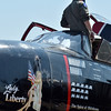 A pilot of the Douglas A-26 Invader watches another plane perform  during Saturday's Rocky Mountain Airshow 2012 at Rocky Mountain Metropolitan Airport. <br /> <br /> August 26, 2012<br /> staff photo/ David R. Jennings