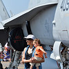 Deshika Adkins and her son Leo, 18 months-old, pose for pictures by a U.S. Navy F-18 during Saturday's Rocky Mountain Airshow 2012 at Rocky Mountain Metropolitan Airport. <br /> <br /> August 26, 2012<br /> staff photo/ David R. Jennings