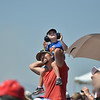 Micah Epperson and his son Gavin, 3, from Thornton, watch the warbirds on parade performance during Saturday's Rocky Mountain Airshow 2012 at Rocky Mountain Metropolitan Airport. <br /> <br /> <br /> August 26, 2012<br /> staff photo/ David R. Jennings