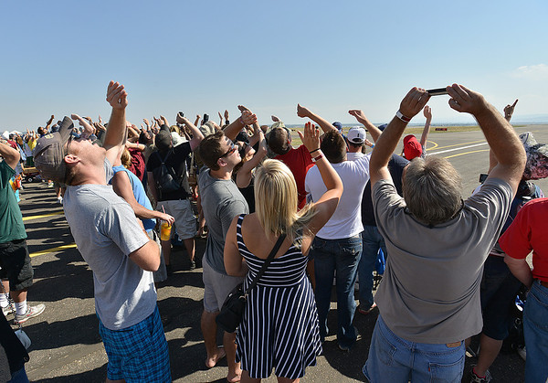 Spectators watch the U.S. Air Force F-22 perform during Saturday's Rocky Mountain Airshow 2012 at Rocky Mountain Metropolitan Airport. <br /> <br /> August 26, 2012<br /> staff photo/ David R. Jennings