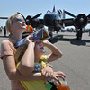 Sarah Higgins and her daughter Anna, 10, from Boulder, watch airplanes performing stunts during Saturday's Rocky Mountain Airshow 2012 at Rocky Mountain Metropolitan Airport. <br /> <br /> August 26, 2012<br /> staff photo/ David R. Jennings