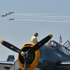 a demonstration team flies past a World War II vintage TBM Grumman Avenger during Saturday's Rocky Mountain Airshow 2012 at Rocky Mountain Metropolitan Airport. <br /> <br /> August 26, 2012<br /> staff photo/ David R. Jennings