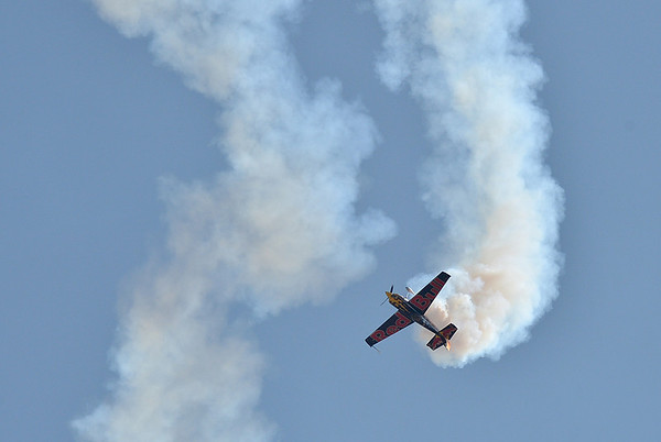 Kirby Chambliss performs stunts with his Red Bull airplane during Saturday's Rocky Mountain Airshow 2012 at Rocky Mountain Metropolitan Airport. <br /> <br /> August 26, 2012<br /> staff photo/ David R. Jennings