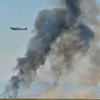 A British Spitfire replica flies past a plume of smoke for a performnce during Saturday's Rocky Mountain Airshow 2012 at Rocky Mountain Metropolitan Airport. <br /> <br /> August 26, 2012<br /> staff photo/ David R. Jennings