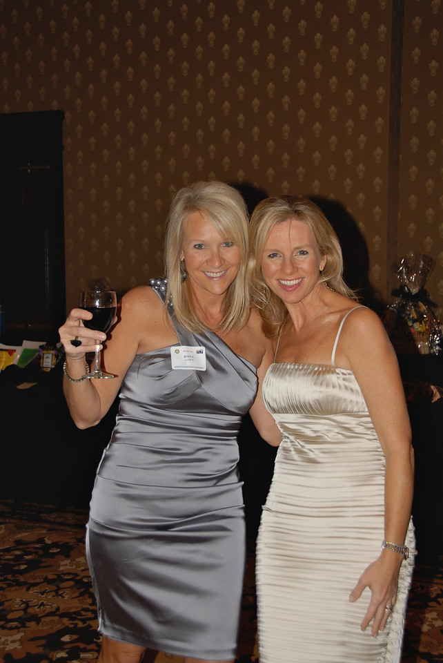 Dana Lulich and Amy Richardson, a board member for A Precious Child, smile for the camera during Odyssey 2010.