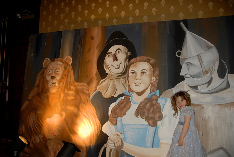 "Lily Conly poses with a poster depicting characters from ""The Wizard of Oz"" during Odyssey  2010 on Friday."
