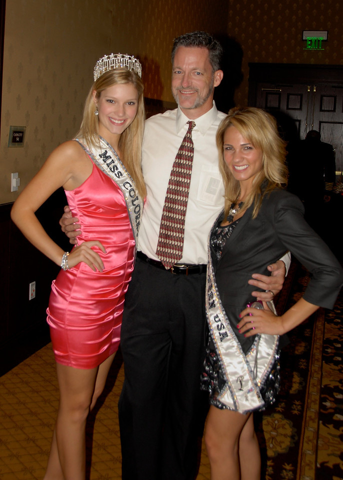 John Karp, from Julie G Photography, poses for a photo with Miss Colorado USA 2010 Jessica Hartman and Miss Teen Colorado Courtney Carter during Odyssey 2010 on Friday.