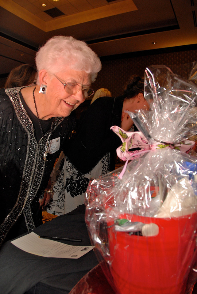 Broomfield Crossing Rotary Club member Betty Calvin looks at a silent auction item at Odyssey 2010.