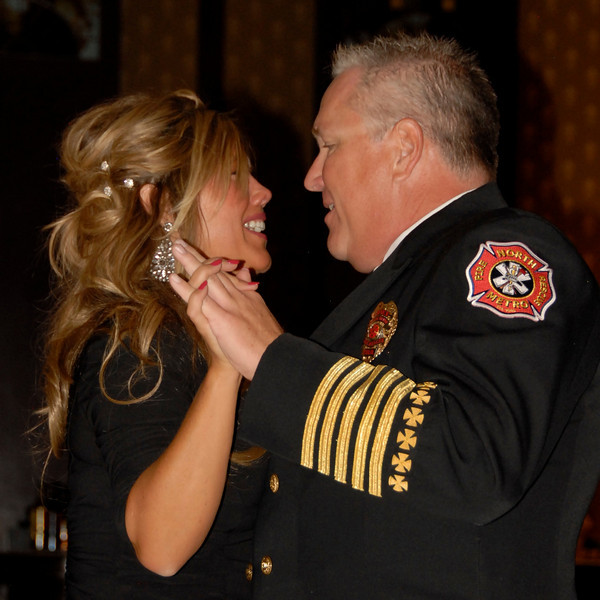 North Metro Fire District Chief Joe Bruce and A Precious Child volunteer Lana Barrett dance at Odyssey 2010 on Friday at the Omni Interlocken Resort.