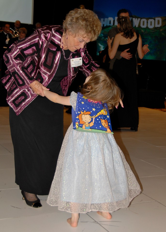 "Marlene Politzer, director emeritus of Bal Swan Children's Center, dances with Lily Conly, who was ""light as a feather,""  to the sounds of the Metropolitan Jazz Orchestra at Odyssey 2010."