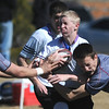 Devon Connor, Tigers Rugby , runs while being tackled during Saturday's game at the Broomfield County Commons championship field, against the Swarm from the southwest metro high schools.<br /> <br /> March 10,  2012 <br /> staff photo/ David R. Jennings