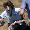 Ben Onaindia, Tigers Rugby , carries the ball while being tackled Saturday's game at the Broomfield County Commons championship field, against the Swarm from the southwest metro high schools.<br /> <br /> March 10,  2012 <br /> staff photo/ David R. Jennings