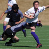 Nicholas Gourgouris, right, Tigers Rugby , is tackled during Saturday's game at the Broomfield County Commons championship field, against the Swarm from the southwest metro high schools.<br /> <br /> <br /> March 10,  2012 <br /> staff photo/ David R. Jennings