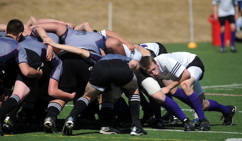 Tommy Spitzer, right, Tigers Rugby , helps form a scrum during Saturday's game at the Broomfield County Commons championship field, against the Swarm from the southwest metro high schools.<br /> <br /> March 10,  2012 <br /> staff photo/ David R. Jennings