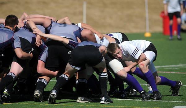 Tommy Spitzer, right, Tigers Rugby , helps form a scrum during Saturday's game at the Broomfield County Commons championship field, against the Swarm from the southwest metro high schools.  March 10,  2012  staff photo/ David R. Jennings
