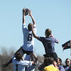 Tommy Spitzer, left, Tigers Rugby , reaches to catch the ball in a line-out play during Saturday's game at the Broomfield County Commons championship field, against the Swarm from the southwest metro high schools.<br /> <br /> March 10,  2012 <br /> staff photo/ David R. Jennings
