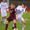 S1019SOCCER10<br /> Silver Creek's #13, Brian Hardy works the ball forward against Broomfield's #16, Tyler Hulst during their game at Broomfield High School on Tuesday evening, October 18th, 2012.<br /> <br /> Photo by: Jonathan Castner