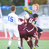 S1019SOCCER8<br /> Broomfield's #15, Connor Metzger collides with Silver Creek's #8, Marcus Gomez, #18, Austin Rankin and goalkeeper#2, Greg Nissen during their game at Broomfield High School on Tuesday evening, October 18th, 2012.<br /> <br /> Photo by: Jonathan Castner