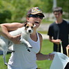 Tracy Owen prepares to wash Dixie, a Jack Russell Terrier owned by Marci Grebing during the Salon Tao's dog wash to benefit local dogs on Saturday.<br /> <br /> <br /> July 21, 2012<br /> staff photo/ David R. Jennings