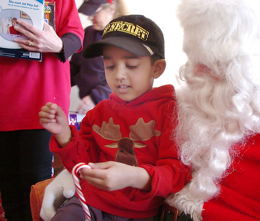 Bal Swan Children's Center student Harman Saron, 4, talks with Santa  at the Louisville Elk's Lodge for the Santa Run on Saturday.<br /> For more photos please see broomfieldenterprise.com.<br /> December 3, 2011<br /> staff photo/ David R. Jennings