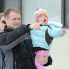 Matt  and JackieTriplett with their daughter Lydia, 3, watch Santa arrive at Bal Swan Children's Center for the Louisville Elk's Lodge Santa Run on Saturday.<br /> For more photos please see broomfieldenterprise.com.<br /> December 3, 2011<br /> staff photo/ David R. Jennings