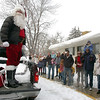 Santa greets Bal Swan Children's Center students and their families before convoying to the Louisville Elk's Lodge for gifts to the students on Saturday.<br /> For more photos please see broomfieldenterprise.com.<br /> December 3, 2011<br /> staff photo/ David R. Jennings