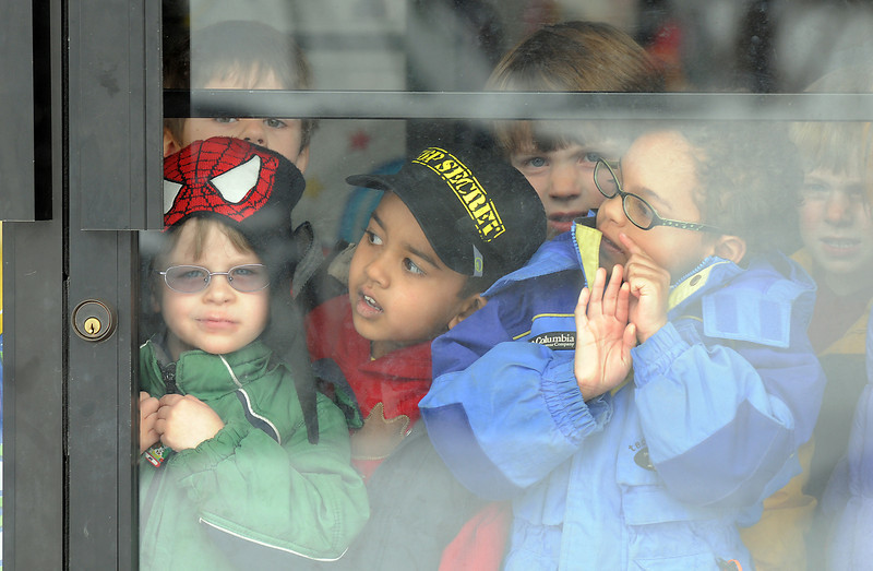 Jay Stone, 4, left, Harman Saron, 4, and Nicholas Tadlock, 4, look for Santa at the front door to Bal Swan Children's Center for the Louisville Elk's Lodge Santa Run on Saturday.<br /> For more photos please see broomfieldenterprise.com.<br /> December 3, 2011<br /> staff photo/ David R. Jennings