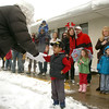 Santa greets Harman Saron, 4, at the Bal Swan Children's Center  before convoying to the Louisville Elk's Lodge for gifts to the students on Saturday.<br /> <br /> For more photos please see broomfieldenterprise.com.<br /> December 3, 2011<br /> staff photo/ David R. Jennings