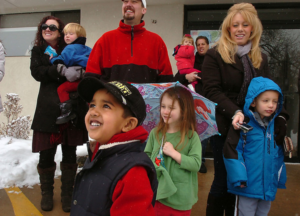 Harman Saron, 4, front, and other Bal Swan Children's Center students and families, greet Santa before convoying to the Louisville Elk's Lodge for presents on Saturday.<br /> For more photos please see broomfieldenterprise.com.<br /> December 3, 2011<br /> staff photo/ David R. Jennings