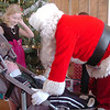 Santa chats with Jacob Hallberg, 6, with his sister Sarah, 9, before giving a gifts to the Bal Swan Children's Center student at the Louisville Elk's Lodge for the Santa Run on Saturday.<br /> For more photos please see broomfieldenterprise.com.<br /> December 3, 2011<br /> staff photo/ David R. Jennings