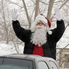 Santa waves to Bal Swan Children's Center students before traveling to the Louisville Elk's Lodge to hand out presents on Saturday.<br /> For more photos please see broomfieldenterprise.com.<br /> December 3, 2011<br /> staff photo/ David R. Jennings