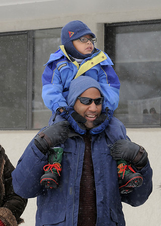Derek Tadlock and his son Nicholas, 4, watch for Santa's arrival at Bal Swan Children's Center for the Louisville Elk's Lodge Santa Run on Saturday.<br /> For more photos please see broomfieldenterprise.com.<br /> December 3, 2011<br /> staff photo/ David R. Jennings