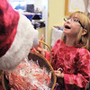 Madeleine Trahan, 6, accepts candy from Santa Claus during Saturday's Santa's Cellar Craft Fair at the Broomfield Community Center.<br /> <br /> November 11, 2011<br /> staff photo/ David R. Jennings