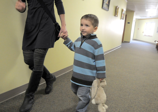 Nicholas Cianciolo, 3, carries his toy rabbit while walking with his mother Mary to Saturday's Santa's Cellar Craft Fair at the Broomfield Community Center.<br /> <br /> November 11, 2011<br /> staff photo/ David R. Jennings