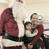 Jessica Lynch and her son Tyler, 16 months-old, pose for pictures with Santa Claus during Saturday's Santa's Cellar Craft Fair at the Broomfield Community Center.<br /> <br /> November 11, 2011<br /> staff photo/ David R. Jennings