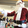 Santa Claus hands out candy canes to customers during Saturday's Santa's Cellar Craft Fair at the Broomfield Community Center.<br /> <br /> November 11, 2011<br /> staff photo/ David R. Jennings