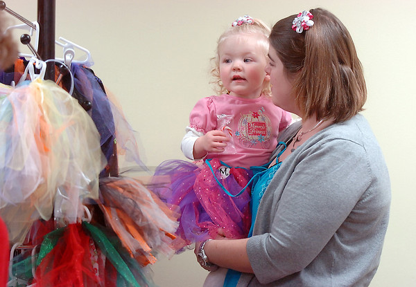 Julie Sturtz and her daughter Molly, 2, look at tutu's  at their booth during Saturday's Santa's Cellar Craft Fair at the Broomfield Community Center.<br /> <br /> November 11, 2011<br /> staff photo/ David R. Jennings