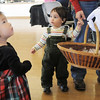 Wren Nguyen, 17 months-old, left, and Tyler Lynch, 16 months-old, wait to pick out candy from Santa Claus at Saturday's Santa's Cellar Craft Fair at the Broomfield Community Center.<br /> <br /> November 11, 2011<br /> staff photo/ David R. Jennings