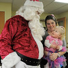 Julie Sturtz and her daughter Molly, 2, talk to Santa Claus during Saturday's Santa's Cellar Craft Fair at the Broomfield Community Center.<br /> <br /> November 11, 2011<br /> staff photo/ David R. Jennings