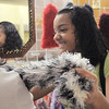 Sabrena Quinlan, 13, right, shows her friend Meaghan Fenton, 14, a boa during Saturday's Santa's Cellar Craft Fair at the Broomfield Community Center.<br /> <br /> November 11, 2011<br /> staff photo/ David R. Jennings