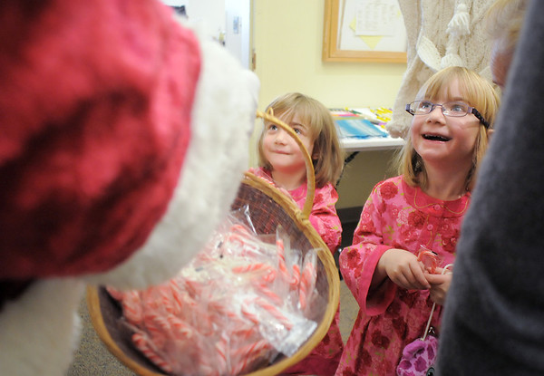 Madeleine Trahan, 6, right, and her sister Sophie, 4, chat with Santa Claus after getting candy canes during Saturday's Santa's Cellar Craft Fair at the Broomfield Community Center.<br /> <br /> November 11, 2011<br /> staff photo/ David R. Jennings