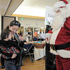 Angie Nguyen holds her daughter Wren, 17 months-old while greeting Santa Claus at Saturday's Santa's Cellar Craft Fair at the Broomfield Community Center.<br /> <br /> November 11, 2011<br /> staff photo/ David R. Jennings