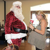 Santa Claus and Roxane Sondrup, who is expecting her baby soon,  compare tummies during Saturday's Santa's Cellar Craft Fair at the Broomfield Community Center.<br /> <br /> November 11, 2011<br /> staff photo/ David R. Jennings