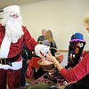 Doris Sauerland accepts candy canes from Santa Claus during Saturday's Santa's Cellar Craft Fair at the Broomfield Community Center.<br /> <br /> November 11, 2011<br /> staff photo/ David R. Jennings