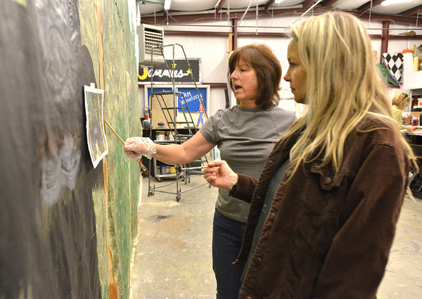 Judy Witt, left, and Tess LeBlanc discuss the gorilla being painted on a mural for Broomfield High School's Just After Midnight after prom event in the JAM Shed at Broomfield High on Saturday.<br /> January 26, 2013<br /> staff photo/ David R. Jennings